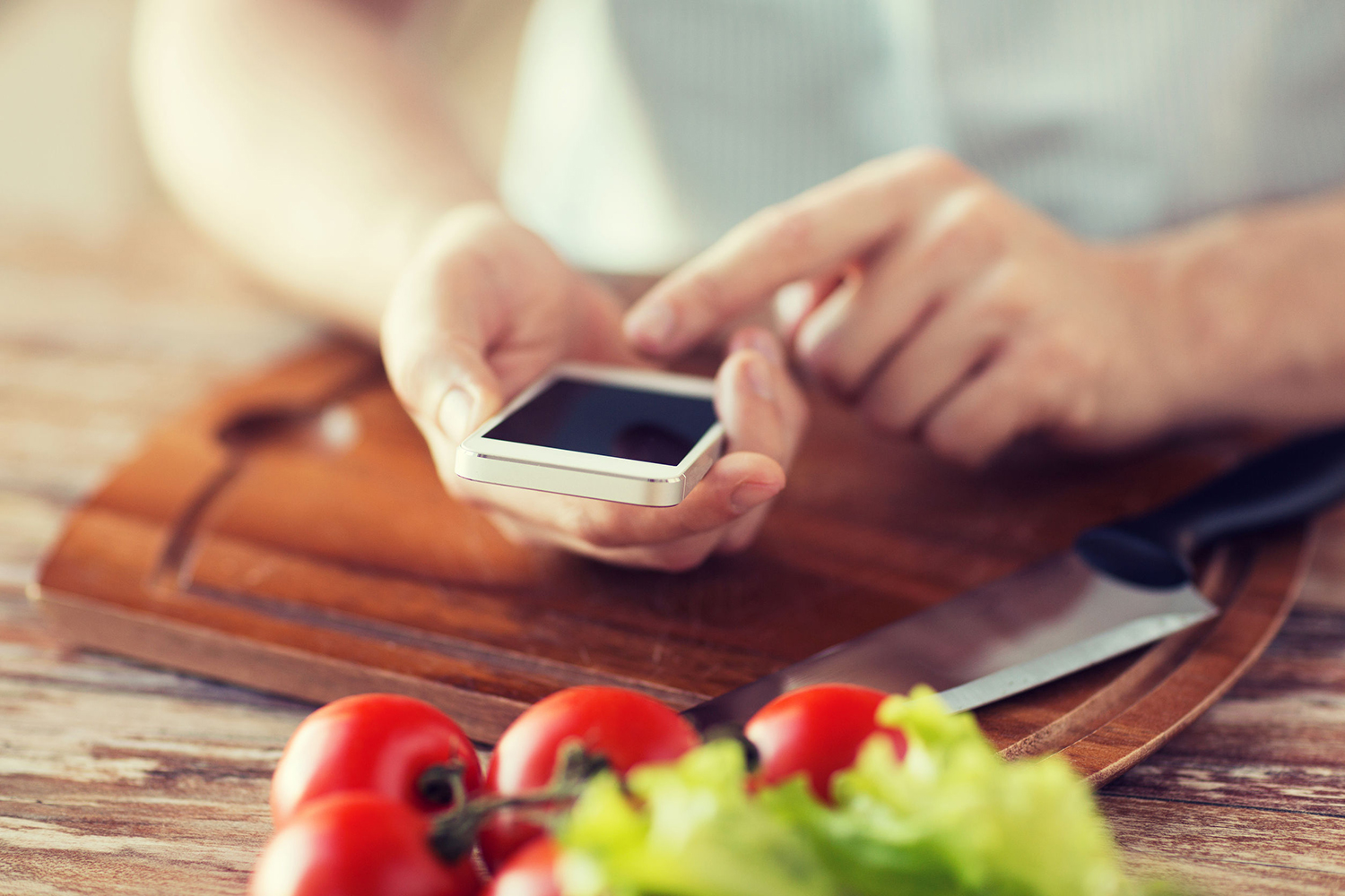35287938 - cooking, technology and home concept - closeup of man pointing finger to smartphone
