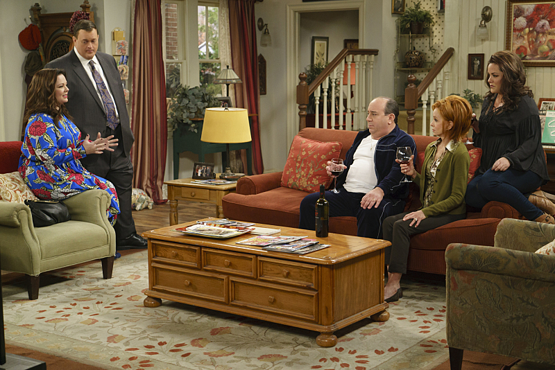 """The Adoption Option"" --Mike and Molly need everyone to be on their best behavior when the adoption agency schedules a home visit, on MIKE & MOLLY, Monday, May 9 (8:30-9:00 PM, ET/PT) on the CBS Television Network. Pictured L-R: Melissa McCarthy as Molly Flynn, Billy Gardell as Mike Biggs, Louis Mustillo as Vince, Swoosie Kurtz as Joyce Flynn, and Katy Mixon as Victoria Flynn Photo: Hopper Stone/CBS ©2015 CBS Broadcasting, Inc. All Rights Reserved"